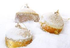 Some christmas balls. Christmas bauble on white snow background royalty free stock photos