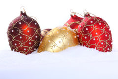 Some christmas balls. On snow royalty free stock photo