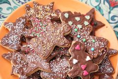 Christmas cookies with chocolate. Some christmas cookies with chocolate and sprinkles of sugar stock photography