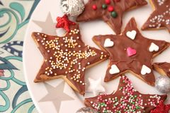 Christmas cookies with chocolate. Some christmas cookies with chocolate and sprinkles of sugar royalty free stock photography