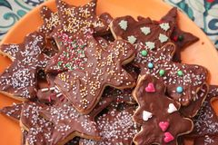 Christmas cookies with chocolate. Some christmas cookies with chocolate and sprinkles of sugar royalty free stock photo