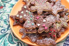 Christmas cookies with sprinkles. Some christmas cookies with chocolate and sprinkles of sugar royalty free stock photography