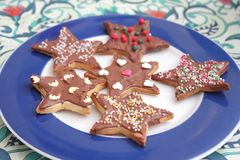 Christmas cookies with sprinkles. Some christmas cookies with chocolate and sprinkles of sugar royalty free stock photo