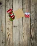 Some christmas decorations and a note. On the twine stock photo