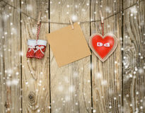 Some christmas decorations and a note. On the twine royalty free stock images