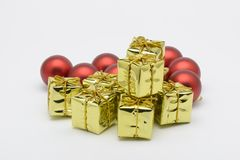 Some christmas decorative yellow boxes. And red balls stock photo
