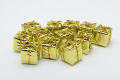 Some christmas decorative yellow boxes. On white background Stock Photography
