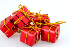 Some christmas gifts. CHristmas red giift boxes with golden ribbon Stock Photos