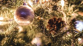 Decorations backlighted on a christmas tree stock images