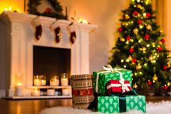 Some christmas presents in a living room filled up. Some nice christmas presents in a living room filled up with winter holidays magic atmosphere. Decorated royalty free stock photography