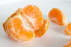 Some clementines on a white background. Some clementines peeled on a white background Royalty Free Stock Photo