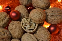 Walnuts combined with red Christmas balls Stock Photos