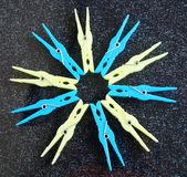 Some clothe pegs in yellow and blue colours. For use after washing clothes royalty free stock photo