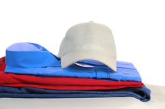 Some clothers. And a hat laying on the grey podium Stock Image
