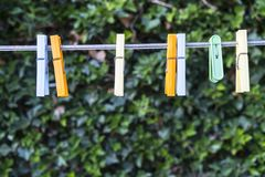Clothespins. Some clothespins on a wire in the garden royalty free stock photo