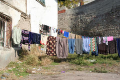 Some clothing are dried on. A rope in back garden Stock Photo
