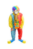 Some clown wearing a gas mask. A man in a clown costume wearing a gasmask on a white background royalty free stock photography