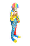 Some clownwearing a gas mask. A man in a clown costume wearing a gasmask on a white background Royalty Free Stock Images