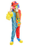 Some clownwearing a gas mask. A man in a clown costume wearing a gasmask on a white background Stock Photos