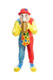 Some clownwearing a gas mask. A man in a clown costume wearing a gasmask on a white background Royalty Free Stock Photography