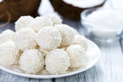Some Coconut Pralines. (close-up shot) on wooden background stock images