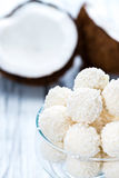 Some Coconut Pralines. (close-up shot) on wooden background royalty free stock images