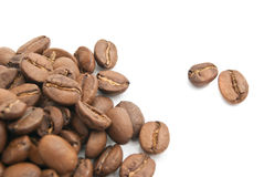 Some coffee beans. Heap of coffee beans on white closeup Stock Image