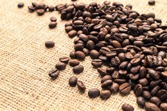 Some coffee beans and a sackcloth background, Horizontal. Some coffee beans and sackcloth background. Horizontal Royalty Free Stock Photography