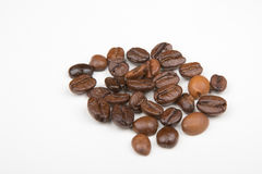 Some Coffee beans. On a white part royalty free stock photo