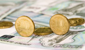 Some coins on banknotes. Some coins on ruble banknotes stock photography