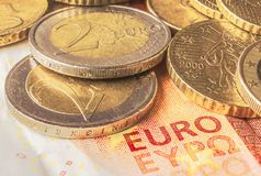 Some coins of euro on a banknote of ten euros. Finance and business concept Royalty Free Stock Image