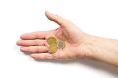Some coins. Male hand holding some coins. isolated on white background royalty free stock photo