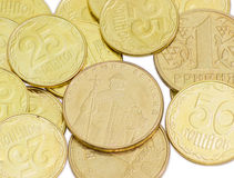 Some coins of the Ukrainian hryvnia closeup. Some coins of the Ukrainian hryvnia different denominations closeup on a light background Royalty Free Stock Photo