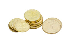 Some coins of the Ukrainian hryvnia on a light background. Three stacks of coins of the Ukrainian hryvnia different denominations closeup on a light background Royalty Free Stock Photos