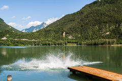 Some always cold slovenia lake. In front of mountains with green colors stock photography