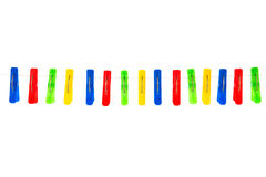 Some colored clothespins on a White background. Colored red, yellow, green, blue clothespins hanging on a rope isolated on white background Stock Photos
