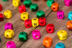 Some colored cubes with letters, sign. With wooden cubes royalty free stock photography