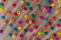 Some colored cubes with letters, sign with wooden. Cubes royalty free stock photo