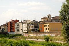 Some colored houses in Parma in Italy. Photo made in Parma in Italy. In the photo, made from the bridge over the tributary of the bit that goes to the city, the stock photo