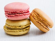 Some colored macaroon. Colored macaroon  on white wood Stock Photography