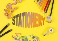 Some colored pencils of different colors and a pencil sharpener and pencil shavings on the yellow background. Word Stationery stock illustration