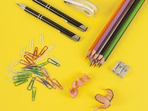 Some colored pencils of different colors and a pencil sharpener. And pencil shavings on the yellow Royalty Free Stock Photography