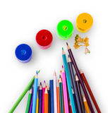 Some colored pencils of different colors. And a pencil sharpeners and pencil shavings on a white background Royalty Free Stock Photos