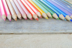 Some colored pencils on a white wooden table. Empty copy space for editor's text Stock Image