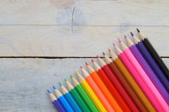 Some colored pencils on a white wooden table. Empty copy space for editor's text Stock Photos