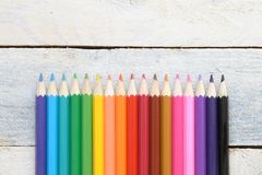 Some colored pencils on a white wooden table. Empty copy space for editor's text Stock Images