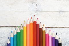 Some colored pencils on a white wooden table. Empty copy space for editor's text Royalty Free Stock Image