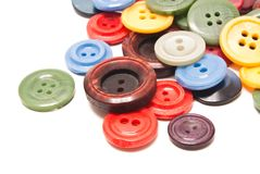 Some colorful buttons on white. Many different clothing buttons on white background Stock Image