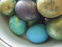 Some colorful eggs in a plate for the Easter. Many colorful eggs in a plate for the Easter holiday Royalty Free Stock Photography