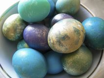 Some colorful eggs in a plate for the Easter. Many colorful eggs in a plate for the Easter holiday Stock Photography